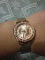 Часы с камешками.