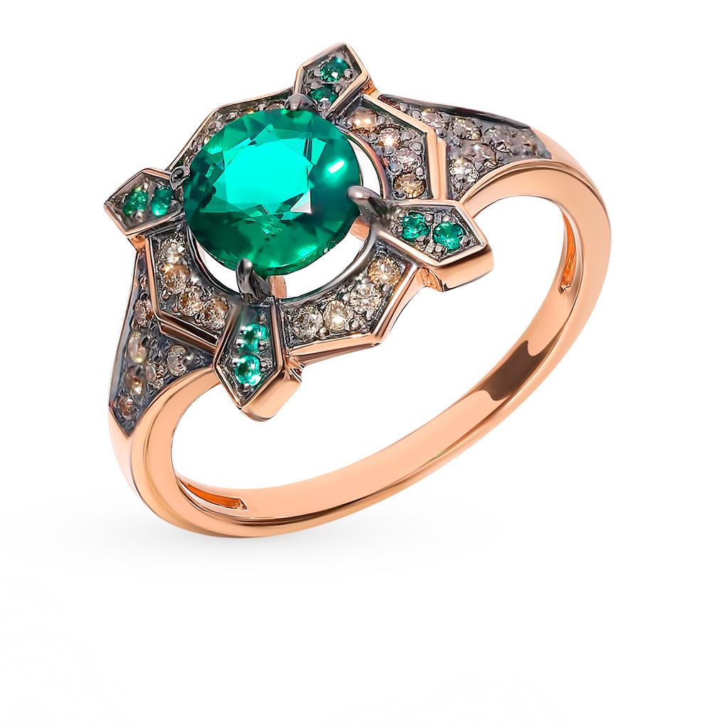 Фото «Золотое кольцо с коньячными бриллиантами и изумрудами»