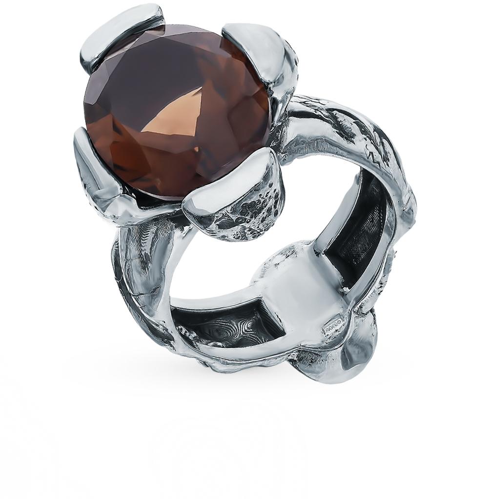 Серебряное кольцо с раухтопазами и гранатом в Екатеринбурге