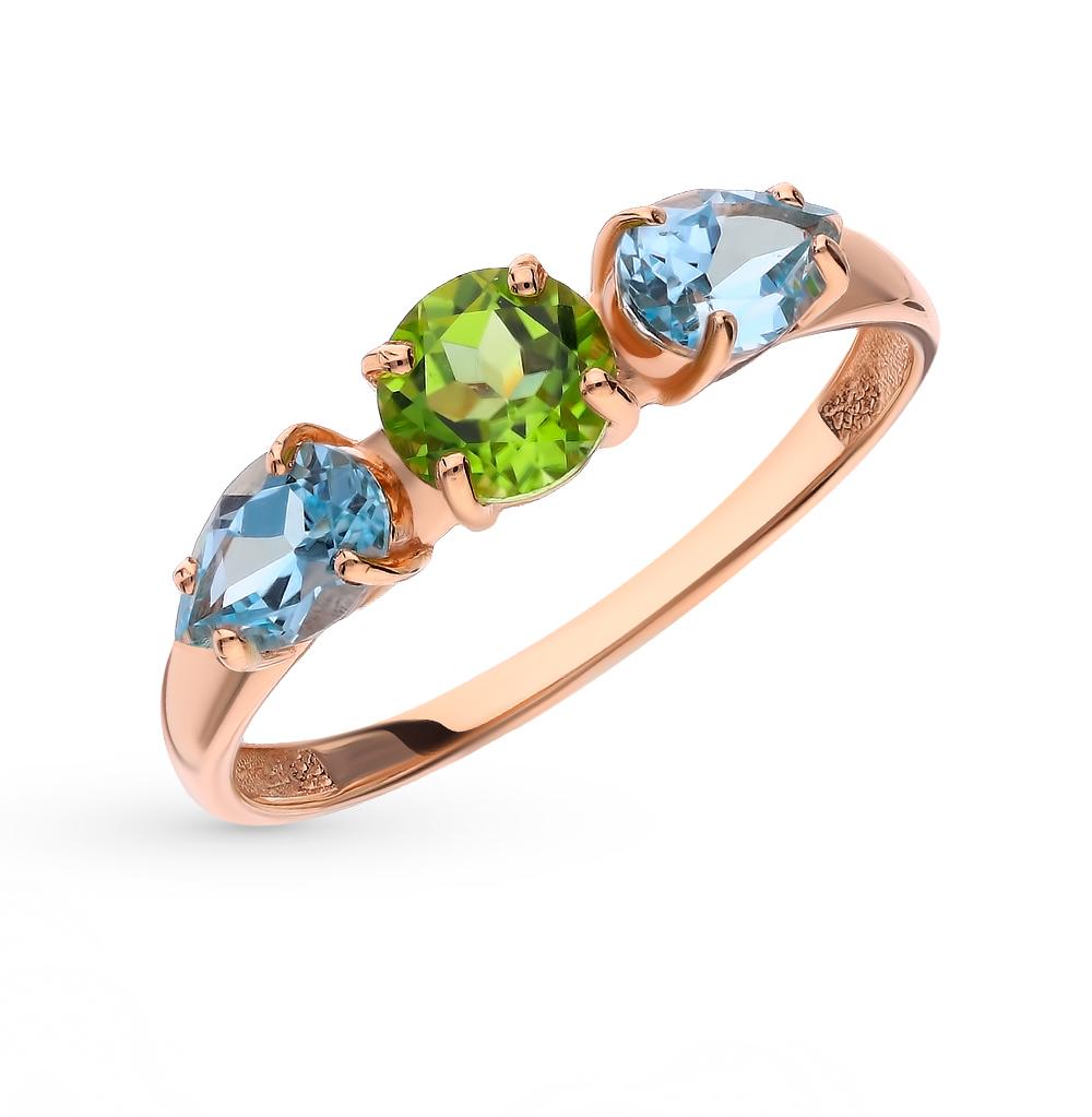 Золотое кольцо с хризолитом и топазами в Екатеринбурге