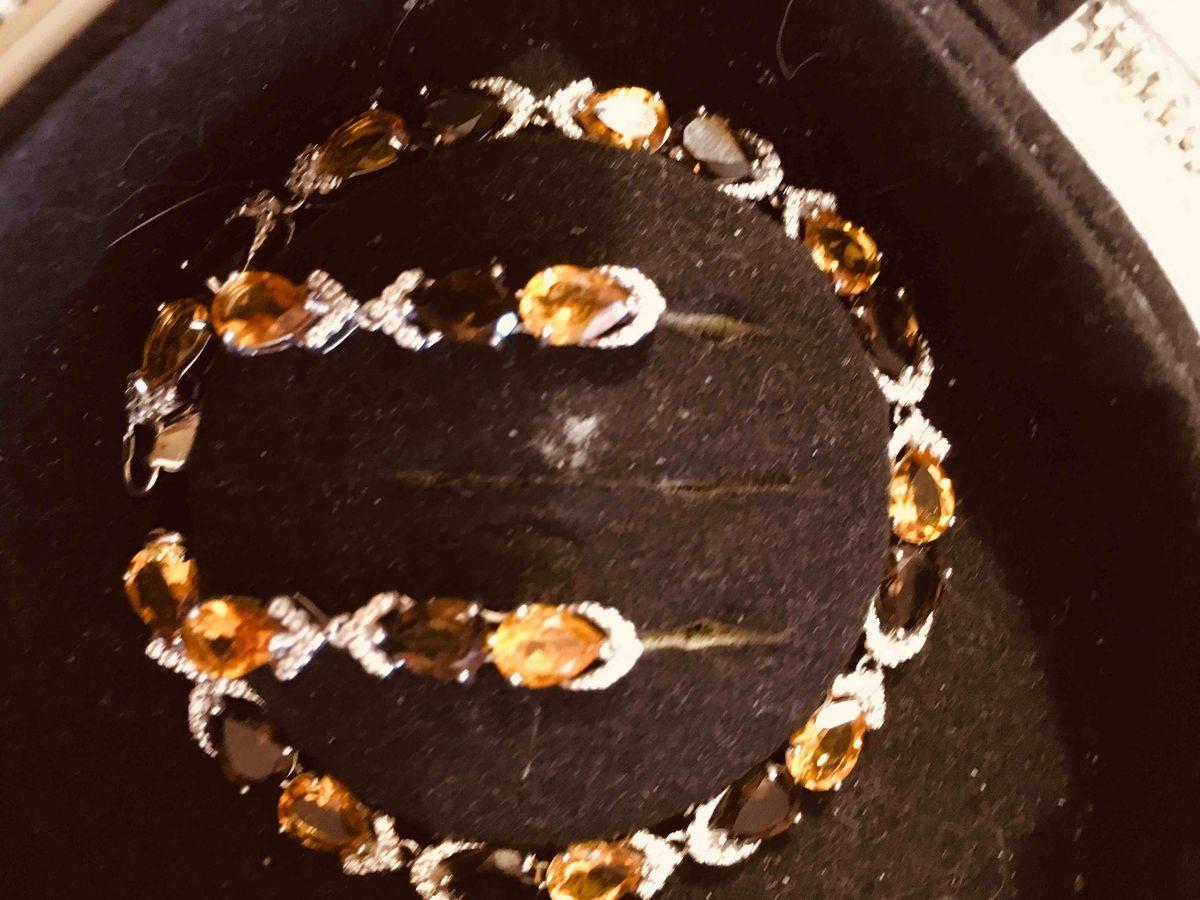 Серебряная брошь с цитринами и раухтопазами.