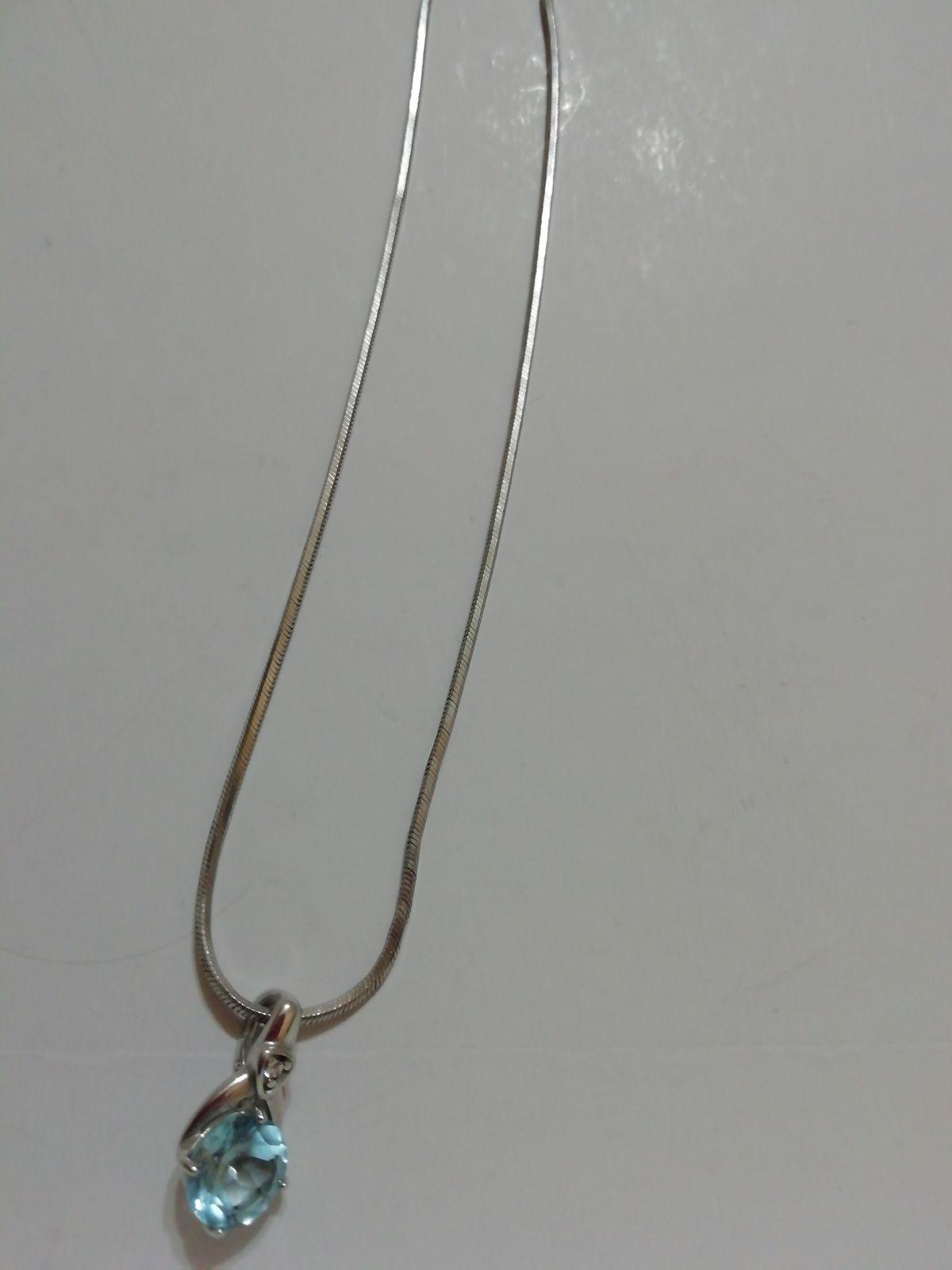Серебряная подвеска с голубым топазом