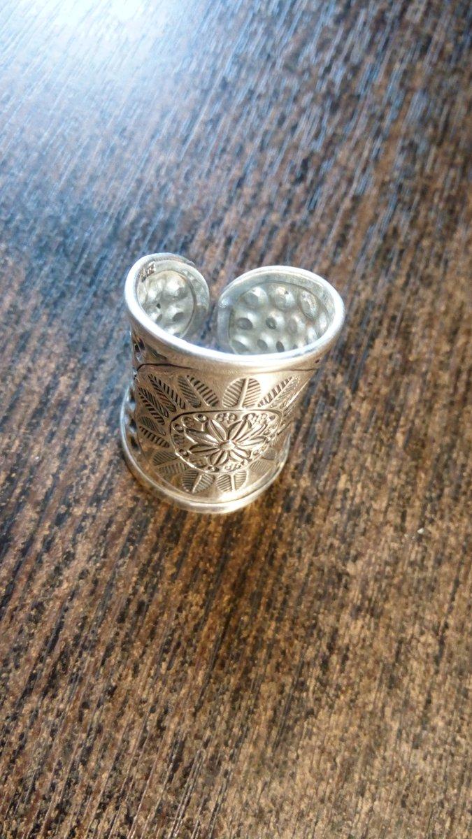 Серебряное кольцо с изображением солнца