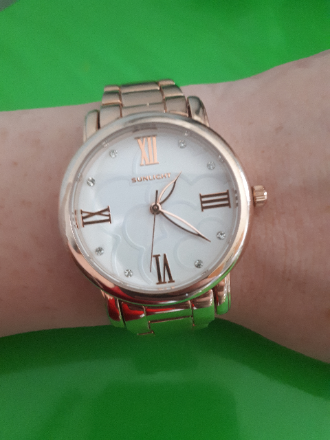Часы в золотом